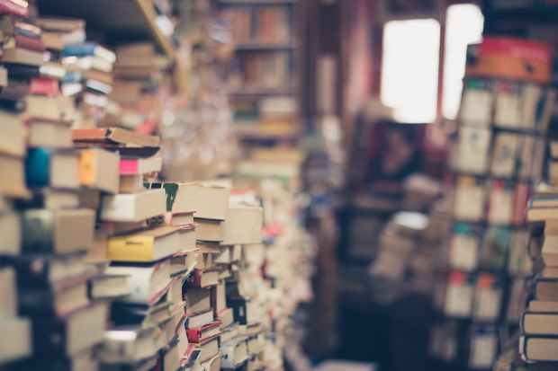 pile of books in shallow focus photography